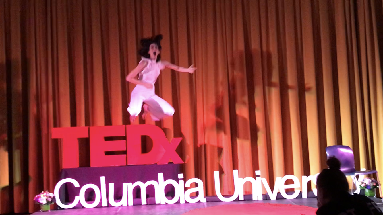 Marquina flying over TEDx Sign - Air Guitar